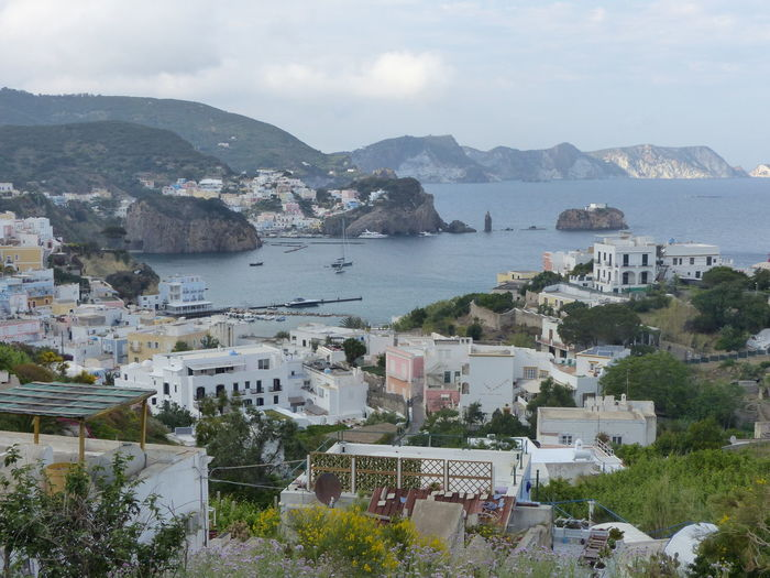 Small village on the sea in the Ponza island in Italy Coast Holiday Seascape Plants Seen By The Tall One Panorama Ponza Island Italy🇮🇹 Architecture Building Exterior Built Structure Cityscape Day High Angle View House Mountain Nature No People Residential Building Sea Sky Town Tree Water Exterior