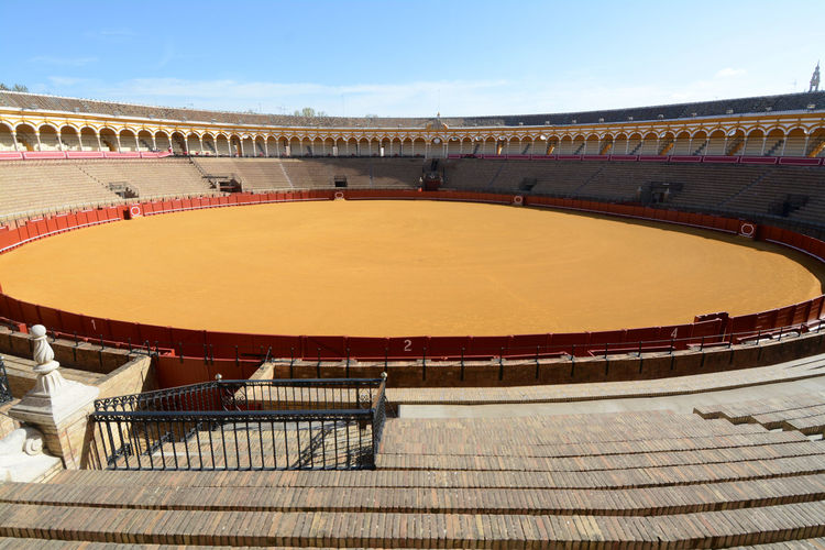 The Bullring of the Real Maestranza of Cavalry of Seville is one of the most beautiful arenasfi of Spain for the biggest bullghters of bullfights. Arenas M Bullfighting Arena Plaza De Toros Real Maestranza Sevilla Toréadores Absence Architecture Arts Culture And Entertainment Building Exterior Built Structure Bullfight Bullring Curve Empty High Angle View No People Outdoors Seat Seville Spain Plaza Sport Stadium Team Sport Toreadore Travel Destinations