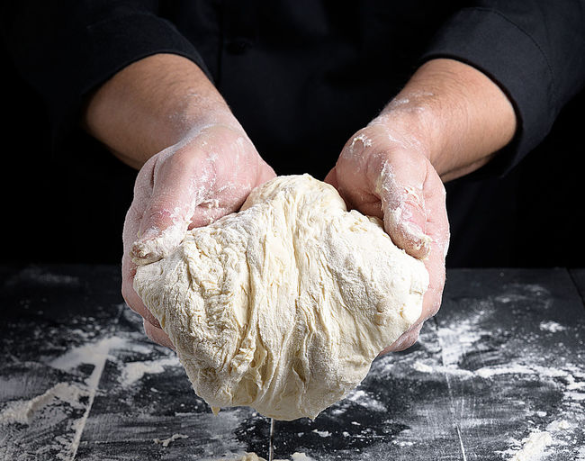 Dough Human Hand Preparation  Food Food And Drink Flour Hand One Person Occupation Kneading Indoors  Bread Freshness Close-up Chef Bakery Baking Bread Baker - Occupation Store Human Body Part Preparing Food Pizza Black Background