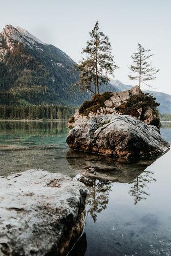 Rocks in lake against sky