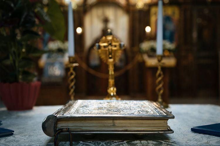 Close-up of illuminated cross on table