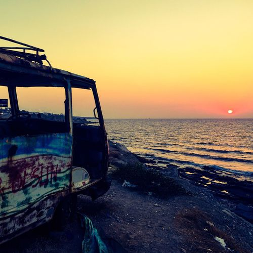 Sunset Sea Water Horizon Over Water Transportation Mode Of Transport Sun Nautical Vessel Land Vehicle Beach Shore Scenics Sky Damaged Outdoors Beauty In Nature Rusty Rust Never Sleeps Rust Lust Rust And Junk RUST ART Rust Color Van Campervan