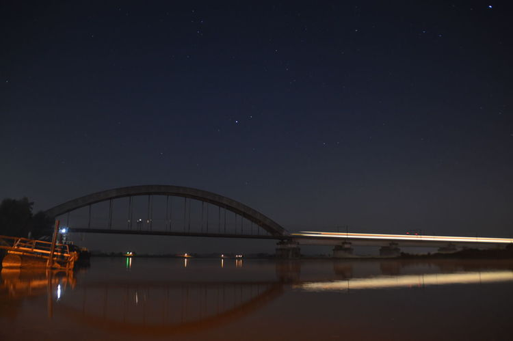 Train heading for a bridge Architecture Bridge - Man Made Structure City Long Exposure Night No People Outdoors Railway Bridge Reflection River Sky Star - Space Train Travel Destinations Water