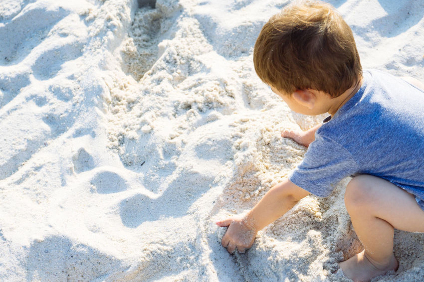 Child Childhood One Person Boy Leisure Activity Nature Land Casual Clothing Sand Beach Day Playing Sunny White Sand Boy Playing In The Beach Playing With Sand Playing With Sand On The Beach Outdoors Innocence
