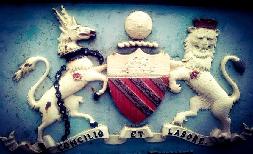 "The Manchester crest. Concilio et labore, means ""By wisdom and effort"". Something like that. Coat Of Arms Crest Concilio Et Labore Manchester"