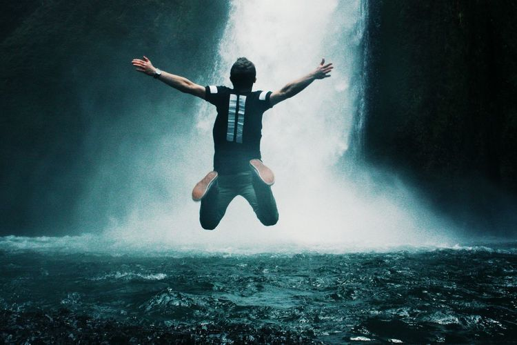 Man Jumping In Waterfall