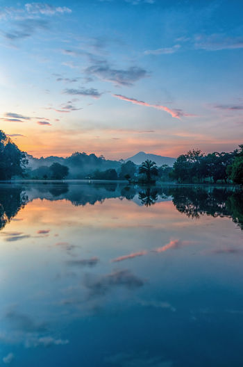 Calm Lake Bogor INDONESIA Beauty In Nature Cloud - Sky Idyllic Indonesia_photography Lake Nature No People Non-urban Scene Orange Color Outdoors Reflection Romantic Sky Scenics - Nature Sky Standing Water Sunset Symmetry Tranquil Scene Tranquility Water Waterfront