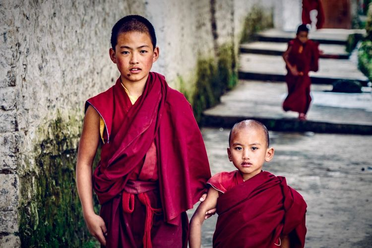 Robe Portraits Two People Religion Red Portrait Looking At Camera Childhood Boys People Streetphotography Spirituality Outdoors Adult Real People Street Photography Tibetan  Tibet Tibet Travel India Arunachal Pradesh Tawang Buddha Temple Buddhist Buddhism An Eye For Travel