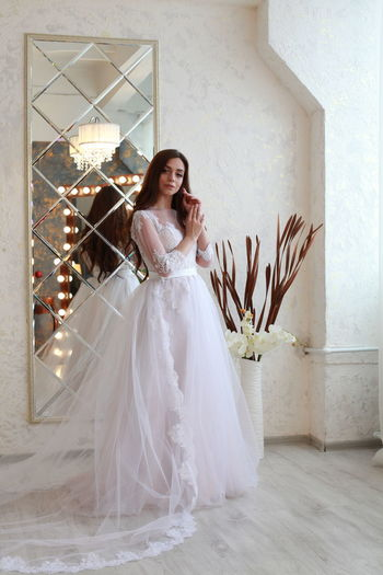 Young Adult One Person Beautiful Woman Full Length Adult Women Beauty Wedding Bride Newlywed Portrait Celebration Looking At Camera Wedding Dress Fashion Young Women Smiling Event Elégance Indoors  Flower Arrangement Hairstyle Teenager