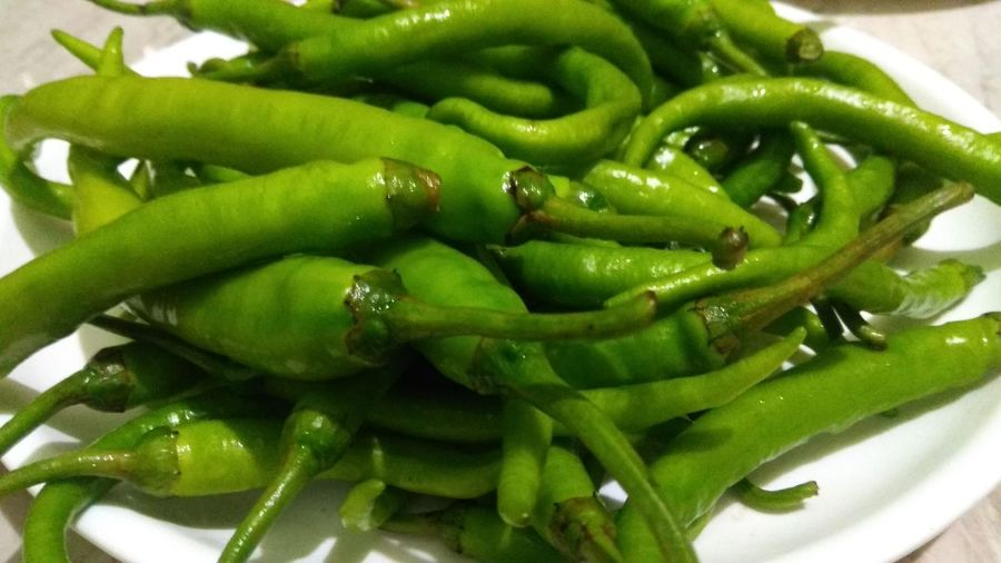 Close-up of green chili peppers in plate