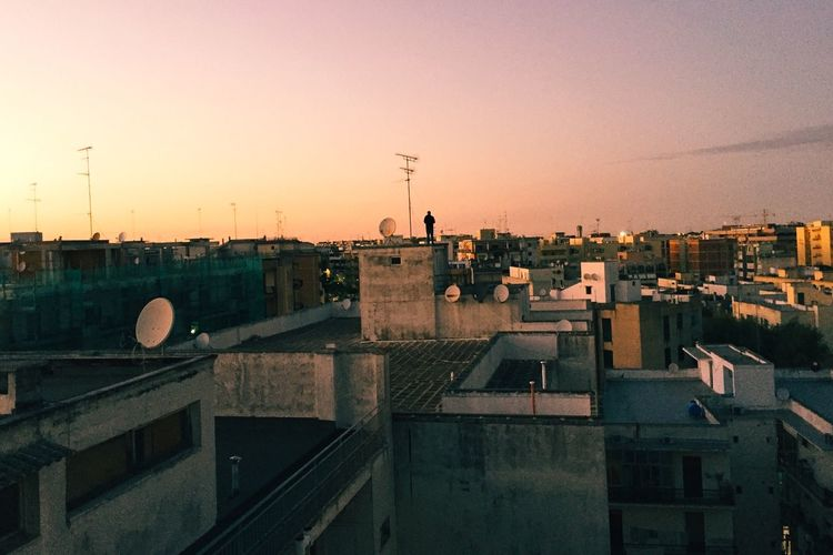 EyeEm Selects Architecture Built Structure Building Exterior Sunset City No People Antenna - Aerial Residential Building Roof Outdoors Satellite Dish Sky Town Cityscape Clear Sky Sunset Parkour Rooftop Nature Technology Day