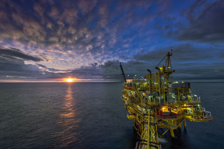 Oil and Gas Industry Oil Industry Platfom Sunrise_Collection Sunrise N Sunsets Worldwide  Sunrise Collection 2018 Sunrise And Clouds Offshore Platform Oil & Gas Development Nightphotography Slow Shutter Cloud Blue Sky Star Bursts Star Burst Behind Light Seascape Sea And Sky Landscape Nature_collection Sea And Sky Lanscape Photography No People Slow Shutter Long Exposure Capture Mornig Good Morning Everyone..... Morning Light Tranquility Offshorelife Nature Crane - Construction Machinery Sky Fuel And Power Generation Machinery Industry Water Cloud - Sky Sunset Sea Transportation Oil Business Drilling Rig Outdoors Fossil Fuel