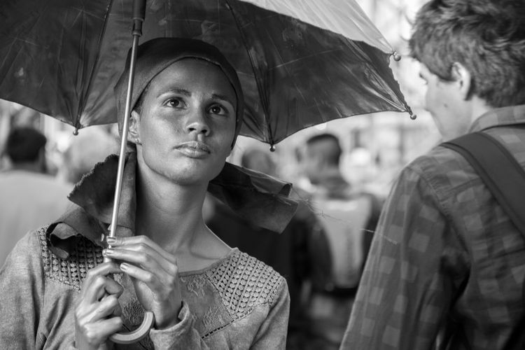 Close-up of young woman holding umbrella