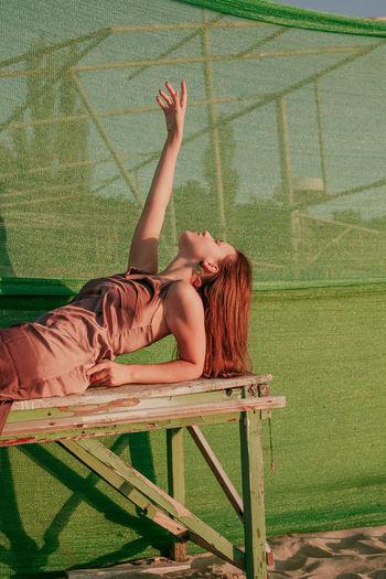 Woman lying on bench
