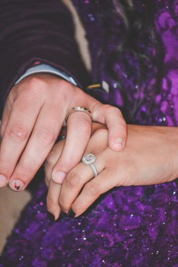 Midsection of couple wearing rings during wedding ceremony
