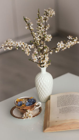 Close-up of white roses in vase on table