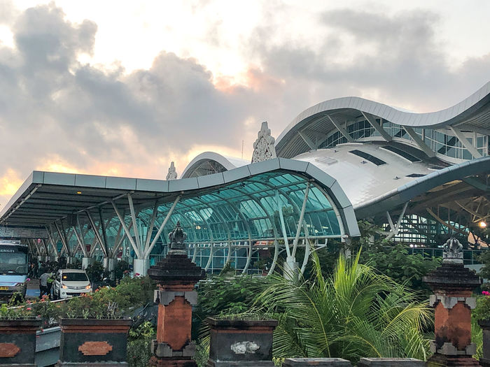 Bali airport Sky Built Structure Architecture Cloud - Sky Nature Plant Building Exterior Day Outdoors Sunset Transportation Greenhouse Travel No People Connection Growth City Mode Of Transportation Bali Airport]] Airport Beauty In Nature INDONESIA