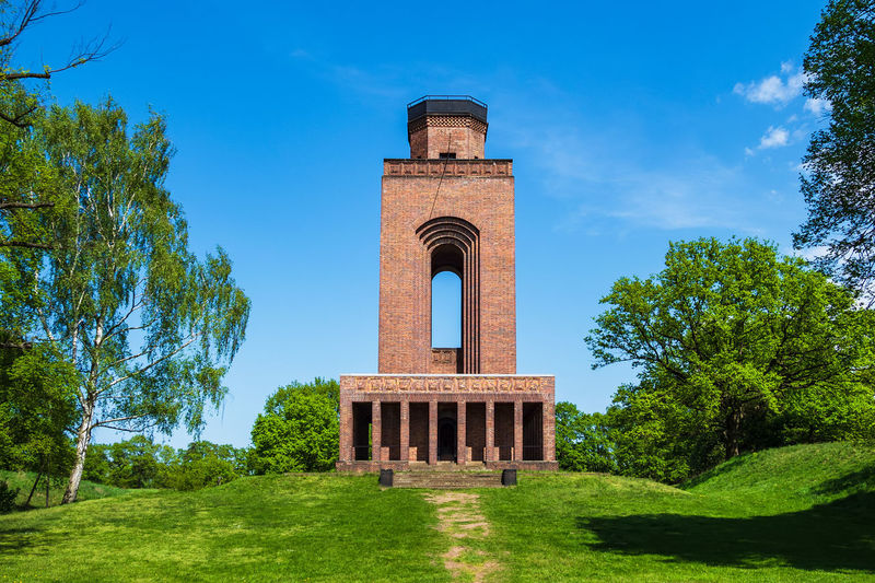 Building in Burg, Germany. Bismarck Tower Burg Tourist Attraction  Architecture Bismarckturm Blue Building Exterior Built Structure Day Grass Green Color History Nature No People Outdoors Plant Sky Spreewald The Past Tourism Travel Travel Destinations Tree Vacation
