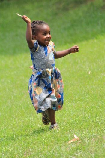 Full length of happy girl on grass