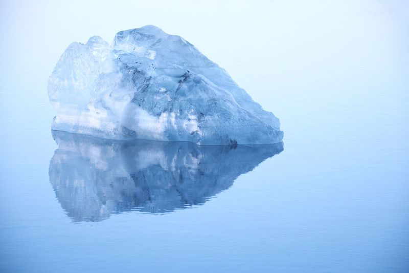 Ice Berg On Sea During Foggy Weather