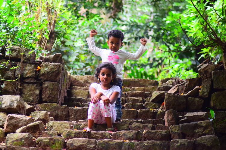 Portrait Of Child On Stone Steps