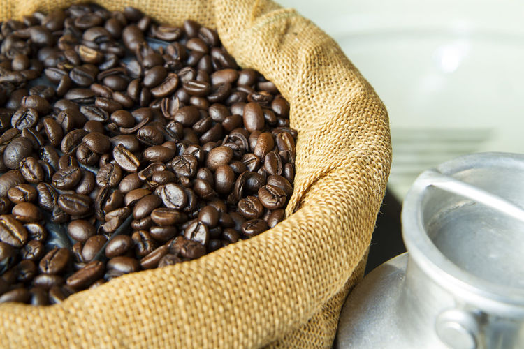 Close up of roasted coffee beans in brown sack