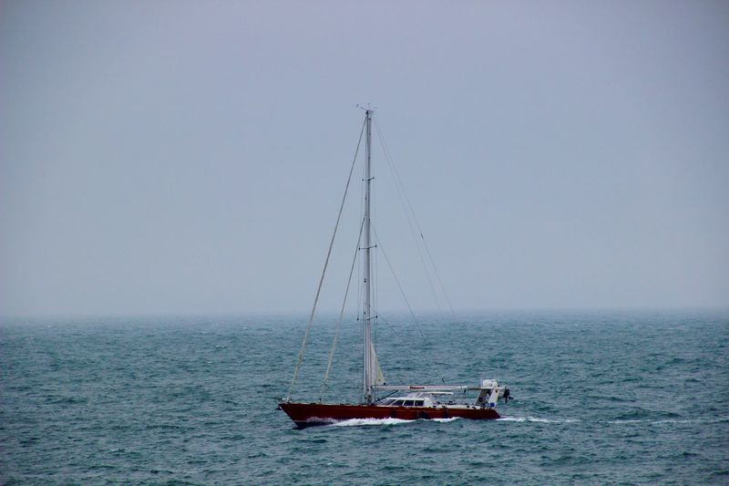 Sailboat water cloudy sky nature scenic Nautical Vessel Sky Nature Mode Of Transportation Horizon Copy Space Outdoors