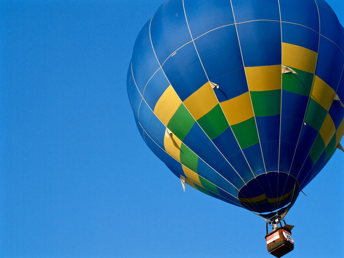 Low Angle View Of Hot Air Balloon In Clear Blue Sky