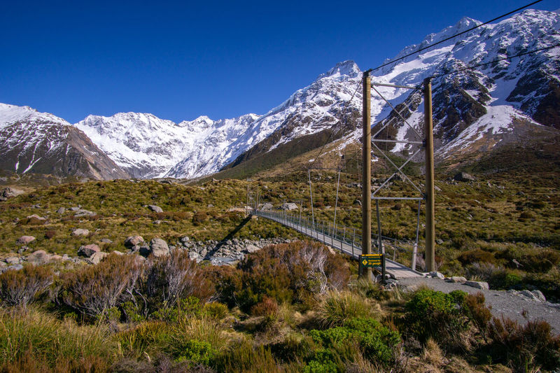Bridge walkway to Mount Cook Mountain Scenics - Nature Snow Cold Temperature Environment Winter Tranquil Scene Landscape Mountain Range Sky Beauty In Nature Tranquility Nature Non-urban Scene Plant Snowcapped Mountain Day No People Land Outdoors Mountain Peak Formation