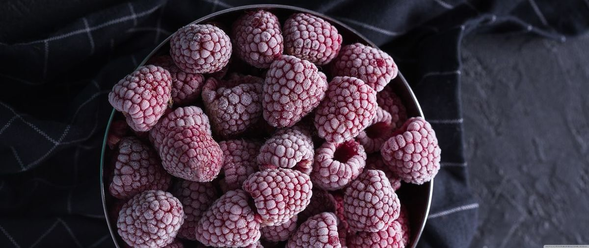 Frosted raspberries in bowl