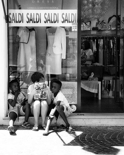Kids. Waiting. Sales Summersales Saldi Sales Time Sommerschlussverkauf Streetphoto_bw Shadows And Sunlight Streetphotography Childhood Streetphotographer Kids Children Children Photography Black And White Photography Bianco E Nero Shadow And Light Street Photography Black And White Collection  Bnw Photography Shadow Noir Et Blanc Schwarz Und Weiß Blanco Y Negro The Essence Of Real People Streetphoto