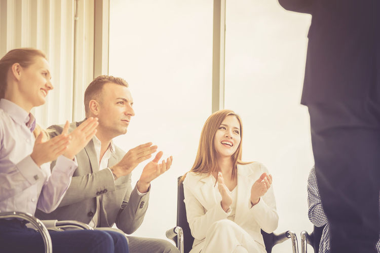 Business people clapping hands at meeting