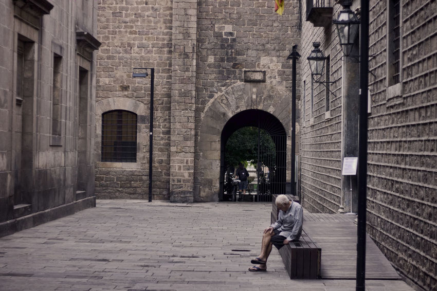 Building Man Sitting Pondering Barcelona Streetphotography Street City Takeiteasy