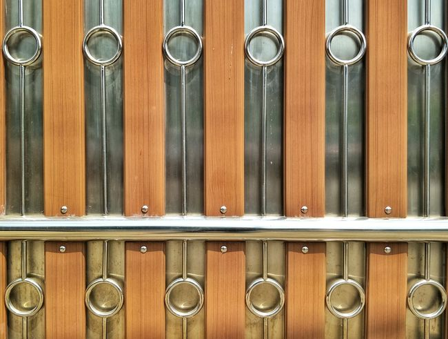 The arrangement of stainless steel and timbers on door decorations Door Slide Decoration Arrangement Pattern Construction Design Architecture Steel Stainless Timber EyeEm Selects Wood - Material Metal In A Row Full Frame Backgrounds Close-up Indoors  No People Pattern Arrangement Day Hinge