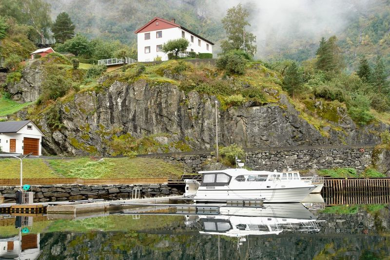 Norway🇳🇴 Reflection Architecture Beauty In Nature Boat Building Exterior Built Structure Day Fjord House Mountain Nature Nautical Vessel No People Outdoors Reflecting Water Scenic Landscapes Scenics Tree Water