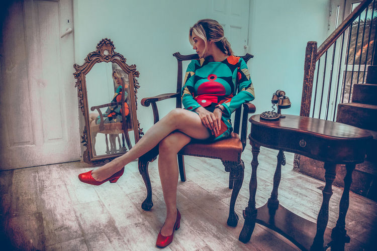 Full Length Sitting Young Adult One Person Young Women Seat Chair Women Real People Beautiful Woman Fashion Indoors  Lifestyles Beauty Clothing High Heels Casual Clothing Hairstyle Armchair #mirror #reflection #colorful #portrait Retro Furniture