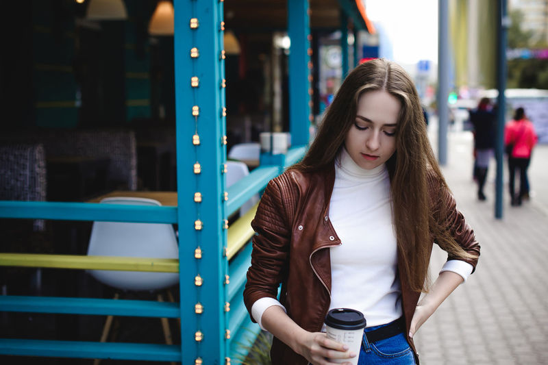Casual Clothing Close-up Day Focus On Foreground Front View Leisure Activity Lifestyles Long Hair One Person One Young Woman Only Outdoors People Real People Standing Women Young Adult Young Women