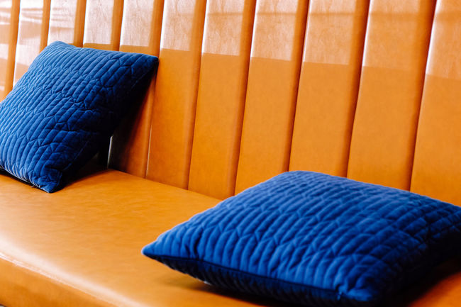 Close up detail of blue pillow on leather sofa Decor Leather Living Orange Pillow Backgrounds Bed Blue Brown Clean Close-up Comfortable Cushion Decoration Decorations Decorative Folded Furniture Furniture Details High Angle View Home Interior Indoors  Interior Design Leather Sofa Living Room Luxury Multi Colored No People Orange Color Pattern Pillow Seat Sofa Softness Still Life Striped Stuffed Textile Wheel
