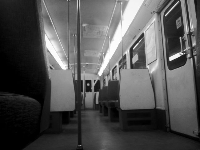 Public Transportation. In an empty Subway Train Light And Shadow.