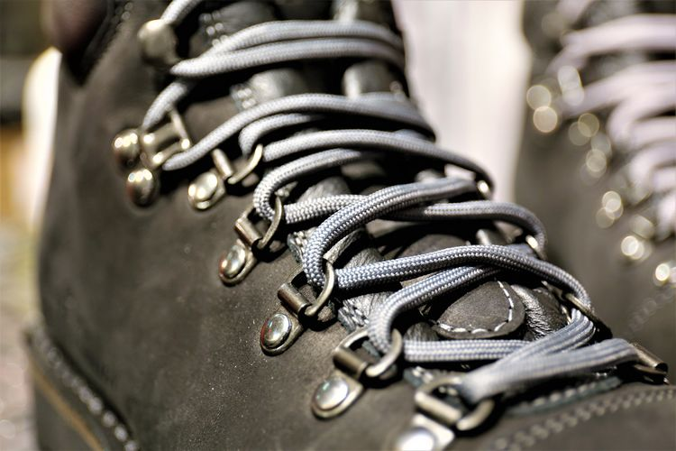Close-up of boot with gray shoelace