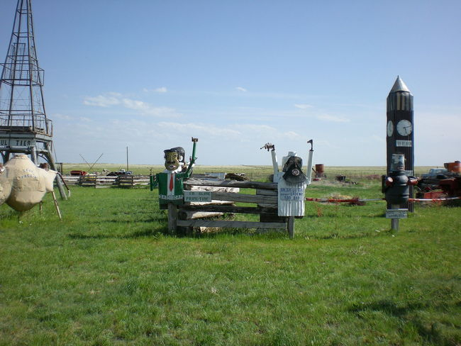 Colorado Junkyard Art Saddam Hussein Text Bin Laden Day Field Grass Junkyard Nature No People Outdoors Satirical Scrap Metal Sculpture Sky
