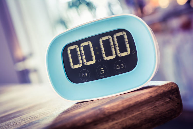 Close-Up Of Digital Clock On Table