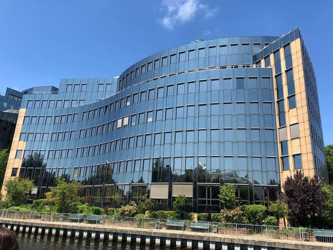 Spree River Berlin Berlin Reflection IPhone X Photography Blue Sky IPhone X Architecture Built Structure Sky Building Exterior Nature Low Angle View Day City Building Sunlight Fence Boundary Outdoors No People Security Tree Plant Blue Barrier Safety