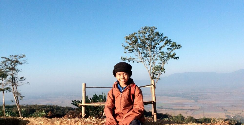 EyeEm Selects Boys Childhood One Person Looking At Camera Tree Portrait Elementary Age Cap One Boy Only Front View Casual Clothing Clear Sky Day Real People Happiness Outdoors Children Only Child Smiling