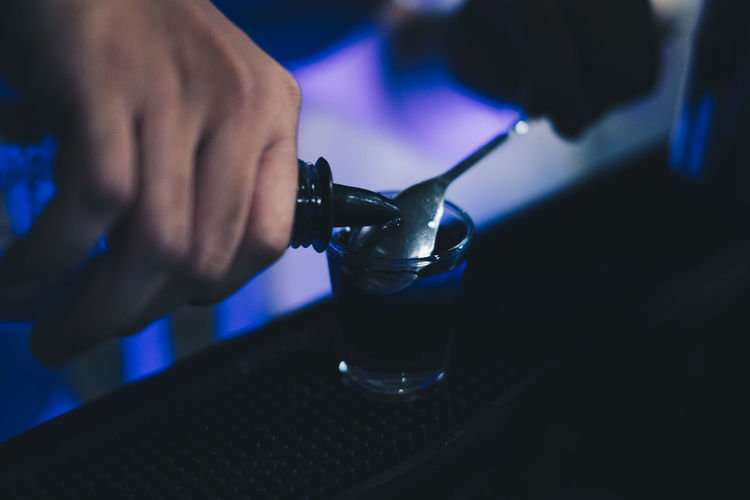 bartender mixing alcoholic drink Human Hand Hand Real People Human Body Part One Person Holding Food And Drink Men Drink Glass Burning Alcohol Human Finger Refreshment Fire Finger Close-up Flame Tequila GIN Vodka Bar Backgrounds Lifestyles Party
