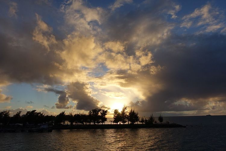 sunset Sky Water Sunset Cloud - Sky Sea Nature Beauty In Nature Scenics No People Tree Tranquility Outdoors Tranquil Scene Waterfront Silhouette Palm Tree Day Saipan Sonyrx100m4 Northern Mariana Islands