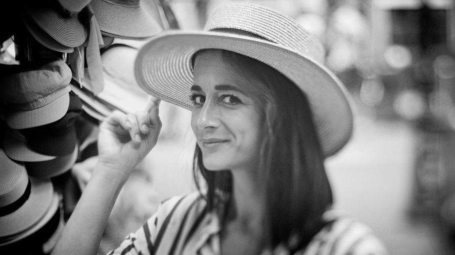 Close-up portrait of woman wearing hat in market