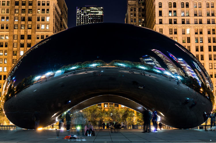 Long Exposure Night Shot Of Cloud Gate In Chicago's Millennium Park Chicago Millennium Park Architecture Building Exterior Built Structure City Cloud Gate Day Illuminated Long Exposure Modern Night Outdoors Real People Tourism Travel Destinations