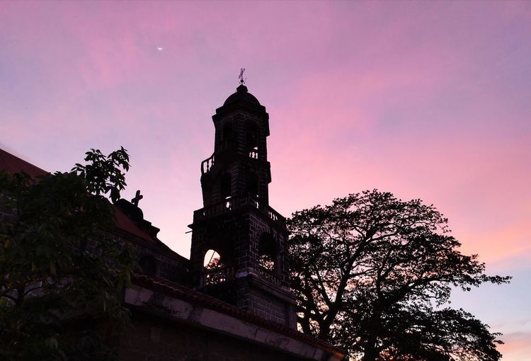 St. John the Baptist Parish Church near Dr. Jose Rizal's house. Spanish Facade Spanish Era The Architect - 2018 EyeEm Awards City Sunset Clock Tower Astronomy History Tree Sky Architecture Building Exterior Built Structure Catholicism Church Christianity