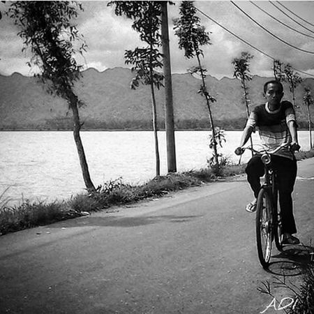 Father Bicycle Central Java,indonesia Flood